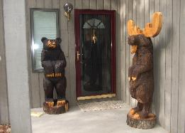Bear and Moose chainsaw carvings