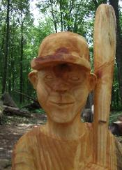 chainsaw carving boy baseball player