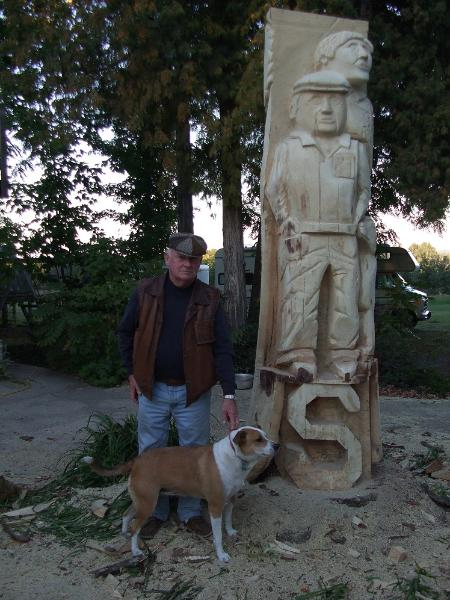 Man and dog sculpture